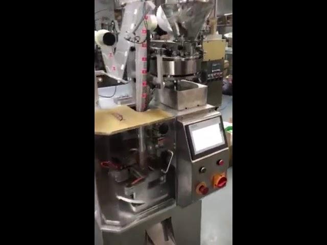 Machine de conditionnement automatique de sachets de thé pyramidale