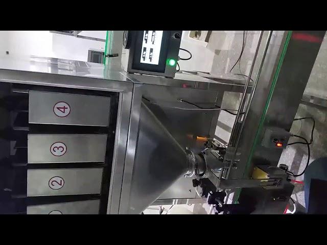 Machine de conditionnement de granulés à quatre seaux pour pesticides, engrais, graines, riz, snacks, additifs